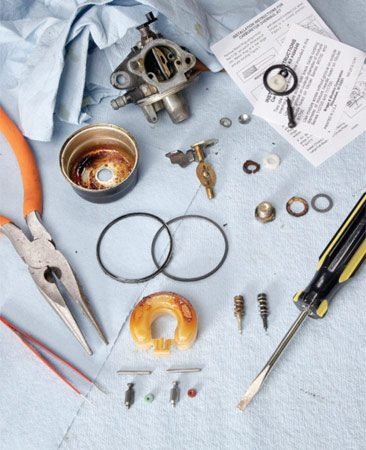 <b>Photo 4: Dissect the carb on your workbench</b></br> Start the disassembly from the bottom (bowl, float, needle, seat, etc.) and keep all the parts together. Shoot digital photos for help during reassembly.
