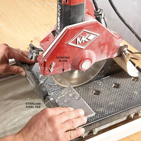 <b>Photo 6: Cut cool with a wet saw.</b></br> Make straight cuts with the wet saw. A dry diamond or abrasive blade will cut stainless steel, but the heat buildup may damage the tile.