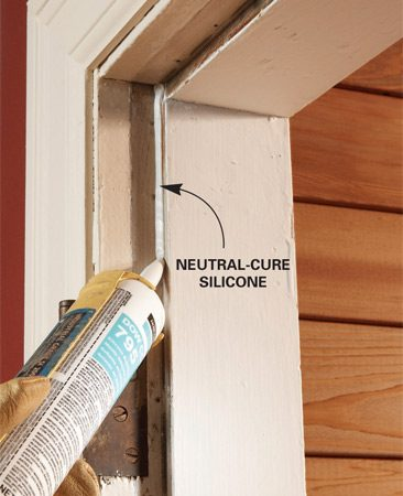 <b>Photo 2: Use silicone caulk for adhesive</b></br> After cleaning the area with toluene, xylene or MEK, apply a thin bead of silicone caulk to the inside corner of the jamb offset. This is where you'll add the new silicone tubing.