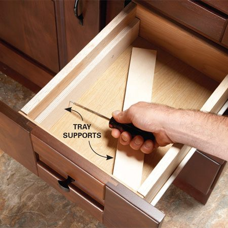 <b>Photo 1: Add tray supports</b></br> Fasten strips of plywood to the drawer to support the tray. You only need two screws per support.