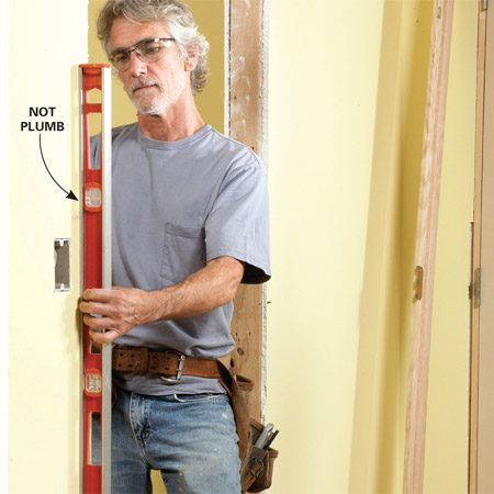 <b>Photo 1: Check for plumb</b></br> Check both sides of the door opening. If they're more than 1/4 in. out of plumb, adjust them before you install the door.