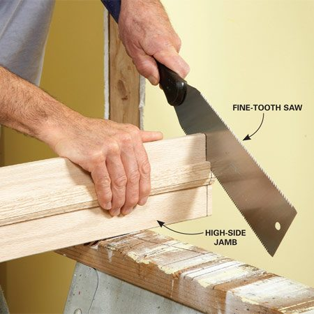 "<b>Photo 2: Cut the high-side jamb</b></br> Trim the jamb with a fine-tooth saw. A ""Japanese""-style pull saw cuts fast and leaves a clean cut."