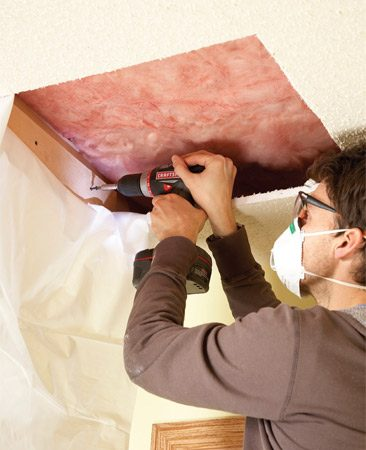 <b>Photo 2: Patch the hole</b></br> Screw 3/4-in.-thick cleats to the sides of the trusses and replace or repair the vapor barrier. Then patch in a fresh piece of drywall.