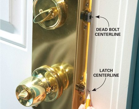 <b>Photo 2: Mark the latch and bolt centers</b></br> Extend the dead bolt slightly and close the door. Mark the center of the bolt on the edge of the doorjamb with a pencil. Then mark the center of the latch on the jamb.