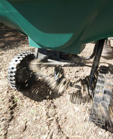 <b>Jump-start the seed</b></br> Spread lawn starter fertilizer into the furrows with a spreader. Don't overdo it.