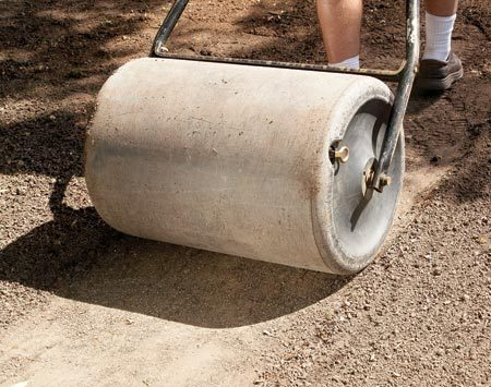 <b>Photo 2: Compact the soil</b></br> Fill a sod roller halfway with water and roll the seed to pack the soil and seed mixture.