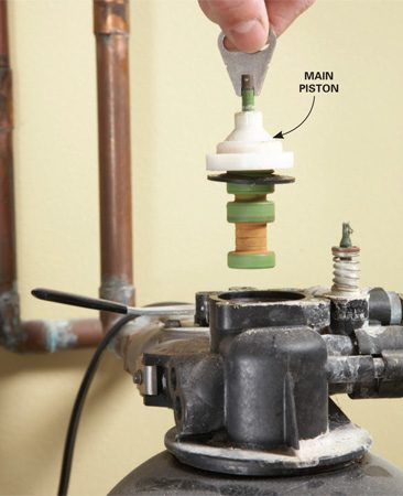 <b>Photo 1: Remove the main piston</b></br> Grab the piston by the metal tang and yank it straight up (the uppermost seal may come out with the piston). Toss the piston.