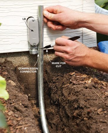 <b>Photo 6: Mark and cut</b></br> Hold the bent conduit in place to mark it for cutting. Since there are no threads on the end of the pipe, screw a compression fitting into the LB and connect the conduit to it.