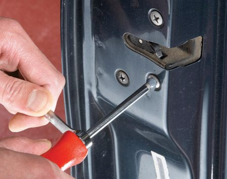 """<b>Photo 1: Coat the tip and turn</b></br> Slip a box-end wrench over the hex-shaped """"boss"""" near the screwdriver handle (if equipped). Then coat the tip with valve grinding compound and jam it into the screw head. Push on the screwdriver while you crank on the wrench."""