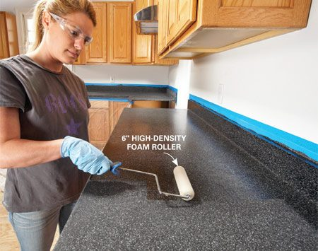 <b>Photo 5: Apply the clear topcoat</b></br> Vacuum up every speck of sanding dust. Then brush a thick, even layer of topcoat on the backsplash and roll out the rest. Reroll a final pass in one direction and let it dry undisturbed for 48 hours.