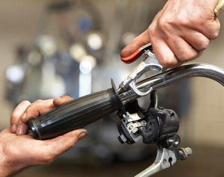 <b>Photo 3: Blow and twist the grip off</b></br> Insert a compressed air gun into the grip and squeeze the trigger. That'll inflate the grip enough so you can twist it and break the adhesive.