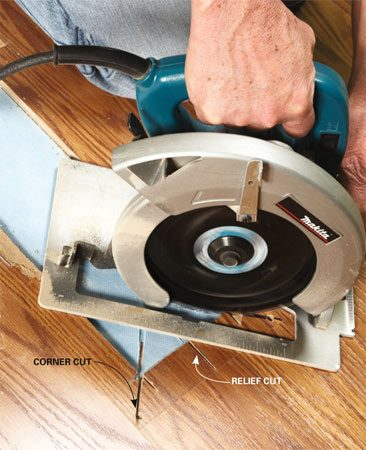 <b>Photo 2: Cut to the corners</b></br> Cut from the center section to the drilled hole in each corner—but no farther! Break out the remainder with a chisel.