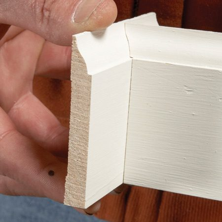 <b>Photo 5: Check your work</b></br> <p>Test the cope with   a scrap of base.</p>  <p>•If the base   is going to be   painted, don't be   a perfectionist—a   small gap is easy to   fill with caulk.   </p>  <p>•If it will be   stained or varnished,   take your   time to achieve a   perfect cope.   </p>  <p>•If you  completely   blow it, who cares?   You can recut   another one in   seconds.   </p>