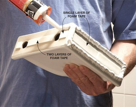 "<b>Photo 1: Tape, shim and caulk</b></br> Add extra layers of foam tape to compensate for an  ""out-of-square"" corner. Then lay a thick bead of caulk around the entire perimeter."