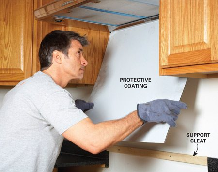 <b>Photo 2: Support the panel with a cleat</b></br> Screw a cleat to the wall so the backsplash will be supported while the adhesive cures. Carefully position the backsplash and press it firmly into place.