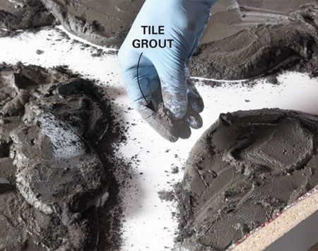 <b>Photo 4: Create the veins</b></br> Sprinkle dry tile grout along the edges of the mounds. The colored powder will form dark lines in the finished top.