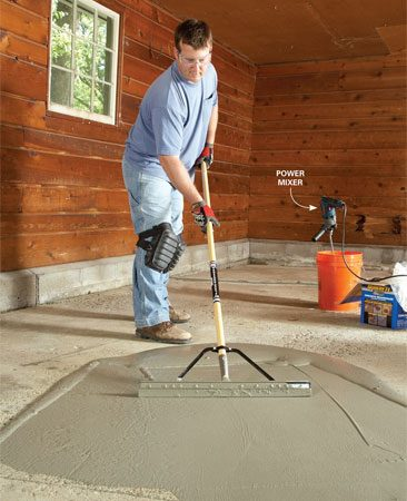 <b>Photo 7: Spread it smooth, then let it set</b></br> Spread from the middle of the puddle. Push the squeegee forward under moderate pressure to work the resurfacer into the concrete and force it into pores and pits. Then drag it back to eliminate edge ridges and to smooth the coating. Continue spreading until you get even coverage. Aim for a thickness of 1/8 in. When you've covered the whole floor, let it cure for 24 hours before you drive on it.