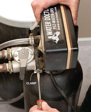 <b>Photo 1: Unhook the unit</b></br> Remove the fasteners that hold the valve head to the bypass valve and pull the unit away from the plumbing. Watch for O-rings or seals so you can reinstall them in the right place.