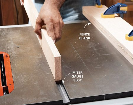 <b>Photo 1: Fit the runner stock</b></br> Slide a hardwood board in the miter gauge slot on your table saw to check the fit. If it's too tight, sand and plane it until it slides easily with no slop. Work on this while you're waiting for the glue to set up on the fence blank (about a half hour).
