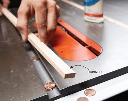 <b>Photo 2: Position the runners</b></br> Rest the runners on pennies to elevate the top edge above the surface of the saw. Apply a thin bead of wood glue down the center of the top of the runners.