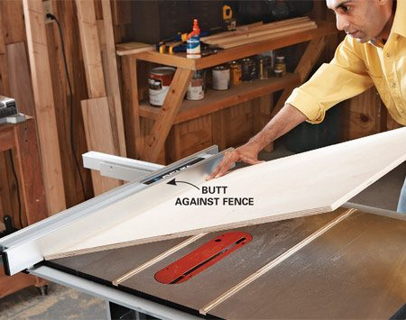 <b>Photo 3: Attach the runners</b></br> Glue the base to the runner, using the table saw fence to position it. Make sure the edge farthest from the fence overhangs the table saw at least 2 in. Set weights on the base until the glue dries.