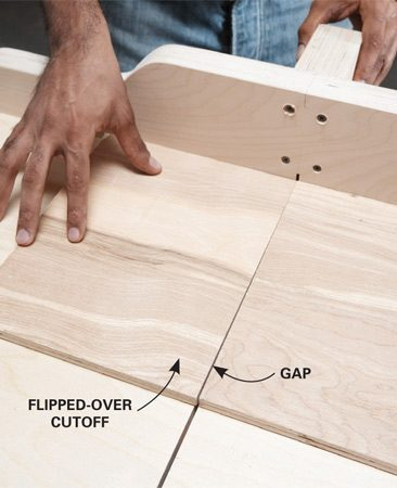 <b>Photo 6: Make a test cut</b></br> Check the position of the fence by cutting a scrap of plywood. Flip one side over and butt the two pieces together. A gap means the fence isn't square.