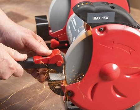 <b>Photo 1: Unclog the pores</b></br> Rest the dresser on the tool rest and start the grinder. Then turn it off and press the tool against the grinding wheel as it slows. Repeat several times until the wheel feels rough to the touch (wait until it stops, please!).