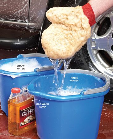 <b>Photo 1: Rinse before you reload</b><br/><p>Rule #1: Swish the wash mitt in clean water before you reload it with fresh suds. Dump and refill the rinse bucket with clean water before you start washing the opposite side of the vehicle, or sooner if the car is very dirty.</p>