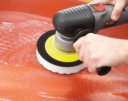 <b>Photo 4: Polish with a light touch</b><br/><p>Run the polisher at a slow speed to spread the compound over the entire area. Then boost the speed and let the polisher do the work for you.</p>