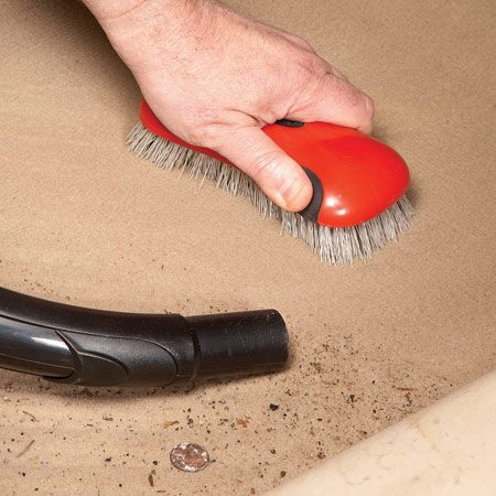 <b>Photo 8: Brush and vacuum</b><br/>Use a stiff brush to &quot;raise&quot; the matted carpet and upholstery fibers. That will loosen trapped dirt so you can vacuum it away.