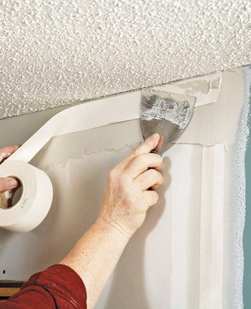 <b>Photo 4: Mud, tape, sand, mud</b></br> Apply joint compound and tape to the vertical seams and embed the tape. Then tape the bottom horizontal seam and finish at the wall-to-ceiling seam. Follow up with sanding and two additional coats.