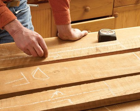 <b>Photo 1: Lay out the parts</b></br> <p>Use chalk to lay out the parts   you expect to get out of the   board. Work around knots,   cracks and edges with deep   tree bark. If there are several   parts coming from the same   board, draw yourself a paper   sketch to remind you of the   layout. Then cut the board to   lengths corresponding to the   parts. Cut each part at least 2   in. longer than the final length.   Do so even if knots, checks or   cracks are part of the waste at   the ends. That'll allow you to   remove any checks on the ends   of the boards or snipe (gouges)   left over from the planer. Don't   work with long boards unless   they're called for; it's much   easier to  flatten short boards. </p>