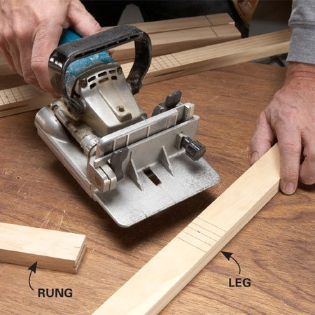 "<b>Photo 2: Cut the biscuit slots</b></br> Cut slots in the ends of the rungs and sides of the legs. Assemble each ladder in a ""dry run"" to make sure they fit together correctly."