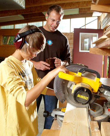 "<b>Jackson at the miter saw</b></br> <p>""What a confidence booster when a kid can say,  'I built that!' "" –Justin</p>"