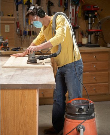 <b>Keep the surface clean</b><br/><p>Connecting to a vacuum   doesn&rsquo;t just cut down on dust.   It actually allows your random   orbit sander to work faster. Even   with the sander&rsquo;s built-in dust collection system, the sander   rides on a thin cushion of dust that prevents full contact   between the grit and the wood. So, by increasing dust   removal, a vacuum improves sander efficiency. On some   sanders, hooking up to a vacuum doubles the sanding   speed. </p>