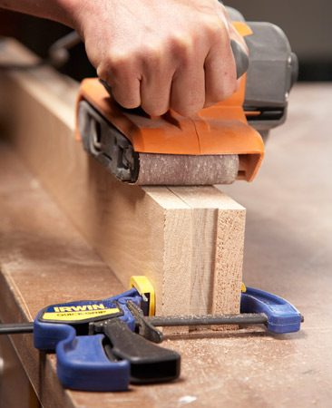 <b>Save time by gang sanding </b></br> <p>Gang sanding with a random orbit or belt sander lets  you   smooth a bunch of edges in one pass. As a bonus, the  wider   surface prevents the sander from grinding too deep in  one spot   or tilting and rounding over the edges. This trick  also makes   sanding a self-correcting process; all the parts will  end up   exactly the same. </p>