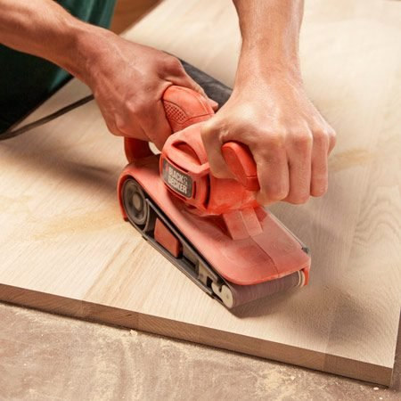 <b>Smooth large areas fast</b><br/><p>The first commandment   of sanding:   Sand with the grain.   But when you have   a lot of wood to grind   off, break that rule and   run your belt sander diagonally   across the grain (at about   45 degrees). Instead of scratching   away at the wood   fibers, the belt will rip   them out. It&rsquo;s incredibly   fast&mdash;and dangerous.   Be careful not   to gouge too deep, and   expect to follow up with some   heavy sanding to smooth the   &ldquo;plow marks&rdquo; left behind. </p>