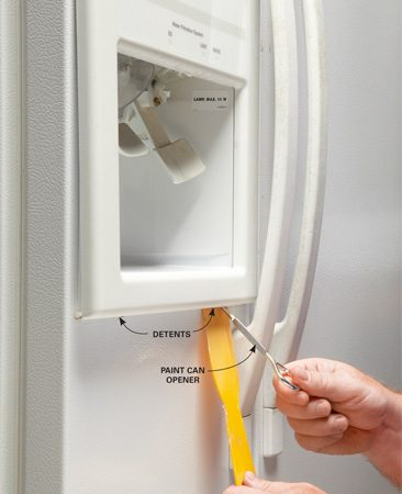 <b>Photo 1: Remove the trim panel</b></br> Locate the detents in the trim panel. Slip a plastic putty knife up against the trim and wedge off the trim with a screwdriver or paint can opener.