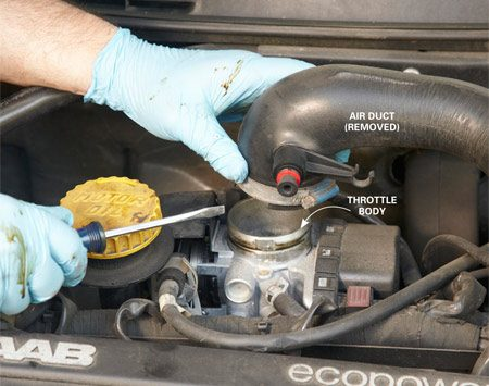 <b>Photo 1: Remove the air duct</b></br> Follow the rubber or plastic air duct from the air filter box up to the throttle body. Loosen the large hose clamp and twist the duct to loosen it. Then lift it off the throttle body.