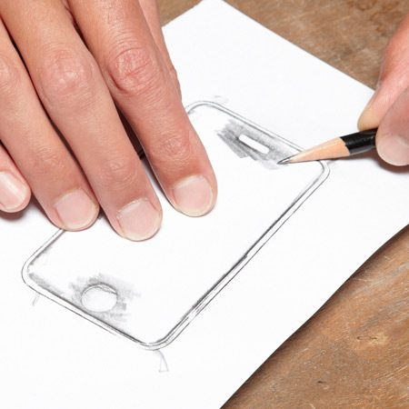 <b>Trace and cut</b></br> To make your own screen protector, place the material over the phone, trace the outline, then cut the shape with a razor knife.