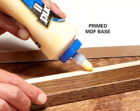 <b>Photo 6: Glue and nail the frame to the base</b><br/>Tack each frame part to the base with two or three brads; that's all it takes to hold them in place until the glue dries.