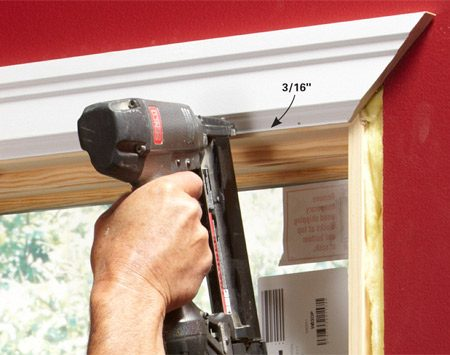 <b>Place the top piece</b></br> Hold the trim 3/16 in. away from the jamb at both ends and along the base of the trim. Nail the trim to the jamb with 1-in. brads spaced about every 6 in. Nail the thick part of the trim to the framing with 2-in. brads.