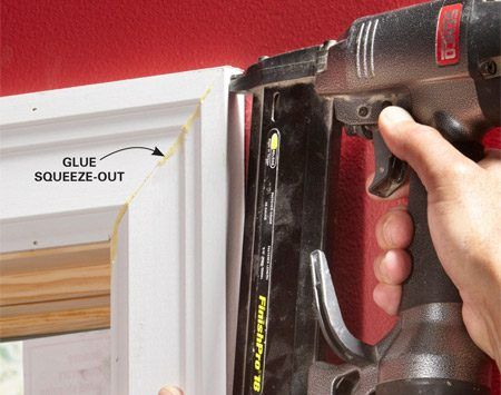 <b>Fasten corners</b></br> Glue and pin together the miter from both directions with 1-in. brads. Wipe the glue squeeze-out with a damp rag right away.