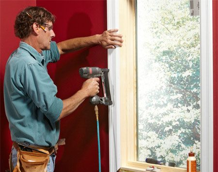 <b>Finish the sides</b></br> Repeat all the same steps on the other side of the window, fitting first the top miter, and then marking and cutting the bottom one. Nail the trim into place.