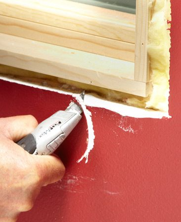 <b>Projects less than 1/8 in.</b></br> If the drywall projects past the jamb 1/8 In. or less, and is close to the window jamb, just chamfer the edge with a utility knife. Check to see if you've pared off enough drywall by holding a chunk of trim against the drywall and jamb. If it rocks and won't sit flush against both surfaces, carve out some more.