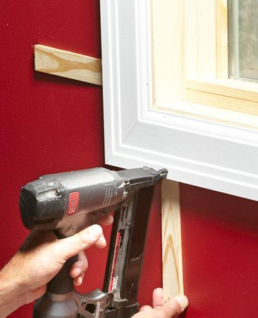 <b>Drywall too low</b></br> If the drywall's recessed behind the jamb, don't nail the trim to the framing at first. Only nail it to the jamb and pin the mitered corners together. After the window is trimmed, slide shims behind each nail location to hold out the trim while nailing, then cut off the shims. Caulk the perimeter of the trim to eliminate gaps before painting.