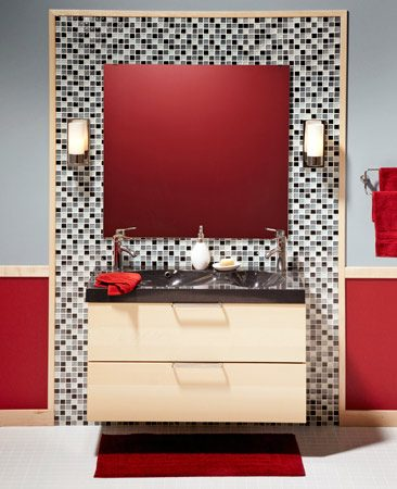 <b>Here's what we did</b></br> <li>Installed a new IKEA   cabinet in place of   the old vanity.</li> <li>Replaced an old   single-bowl vanity   top with a modern   double-bowl top and   faucets from IKEA.</li> <li>Added a big mirror   to make the room   feel spacious.</li> <li>Improved the lighting   by adding   sconces on the sides   of the mirror.</li> <li>Added style and   punch with decorative   glass tile.</li> <li>Tied it all together   with new birch trim   to match the   cabinet.</li>
