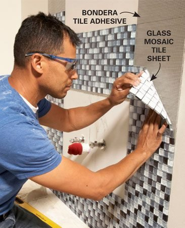 <b>Photo 7: Install the tile</b></br> Position the tile carefully and press it just hard enough to hold it in place. When you're sure the tile is straight and the joints line up, tamp the tile with a grout float to adhere it.