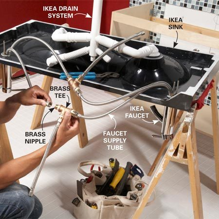 <b>Photo 10: Mount the faucets</b></br> Follow the faucet instructions to mount the faucets to the sink. Installing the faucets and drain plumbing is easier if you do it before installing the sink on the cabinet.