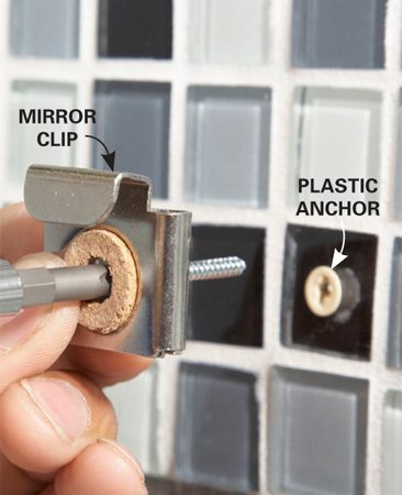 <b>Photo 13: Install the mirror clips</b></br> Tap a plastic hollow-wall anchor into the hole and screw the clip into the anchor. If the hole landed over a stud, you don't need the anchor.